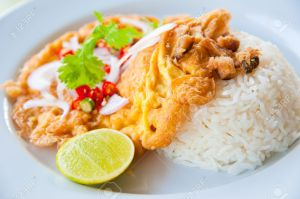 10193391-Delicious-traditional-Thailand-food-Hot-rice-with-omelet-pork-green-herbs-and-chili-sauce-Stock-Photo